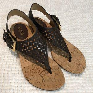 Michael Kors gold-buckle sandal.